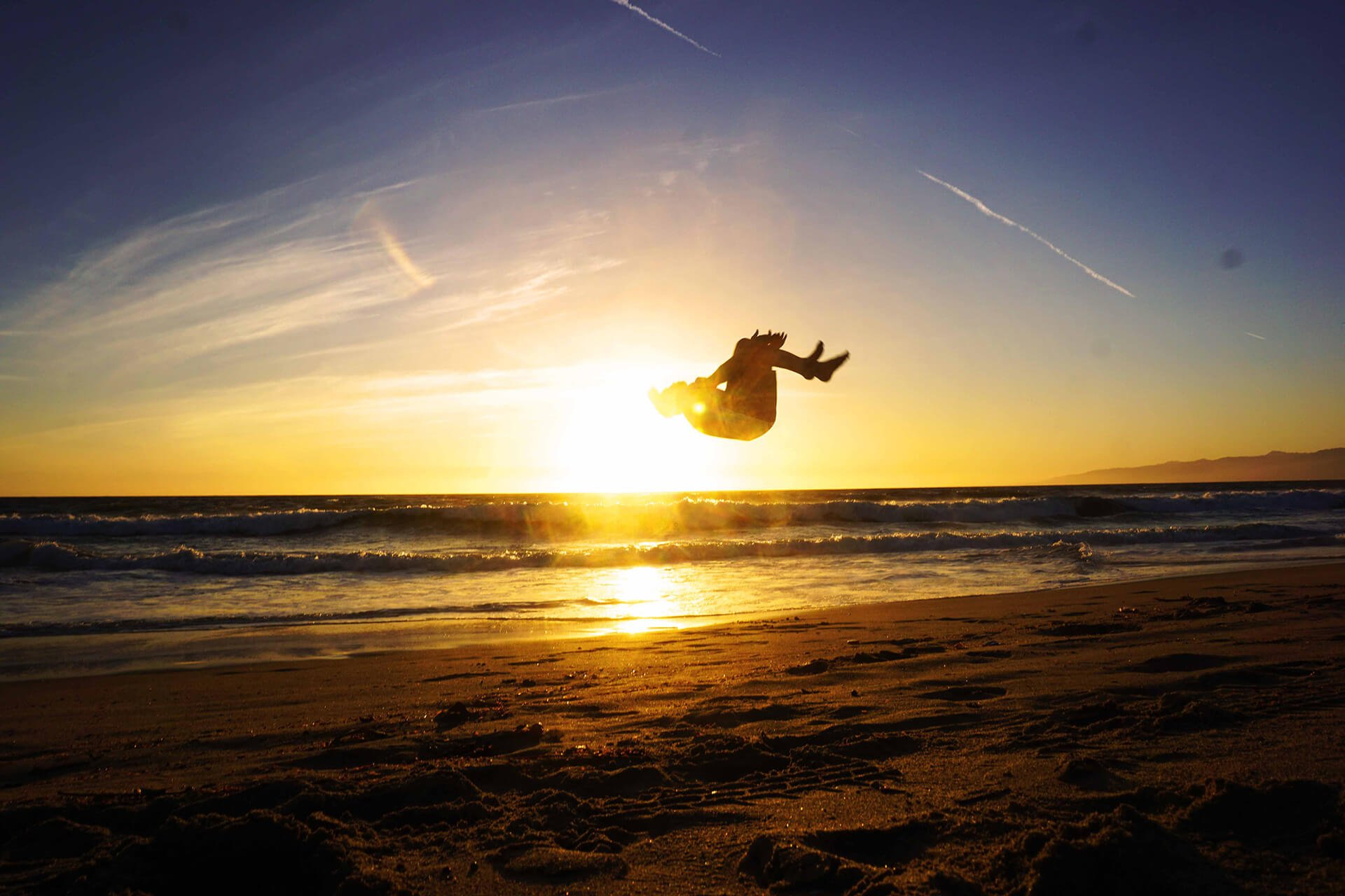 Clemens Millauer backflip on the beach